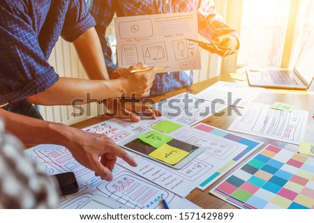 Soft Focus,A team of UI / UX web designers are working together to develop a mobile responsive website with UI UX Front End Designer Previewing. Website development concept UI UX front end designer