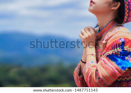 Soft focus,A woman is meditating to pray to bless the Lord with faith in the sacredness and power of God on the blurred background of the sunlight in the morning.The concept of God and spirituality.