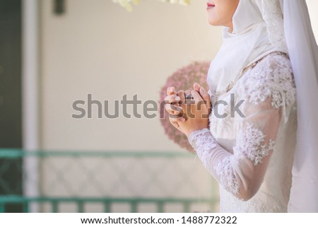 Soft focus,A woman is meditating to pray to bless the Lord with faith in the sacredness and power of God on the blurred background of the sunligh in the morning. The concept of God and spirituality.