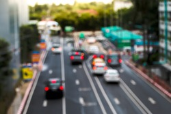 Soft focus and blurred traffics in the city, traffics on main road, background car in urban.