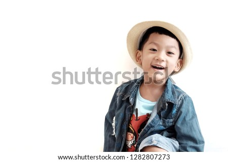 7b9a961e82b42 Soft focus at Portrait Asian kid 4 year old wearing cowboy hat and sit on  bench