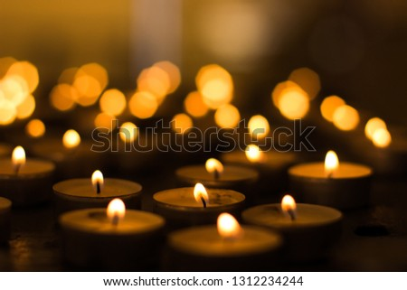 soft focus atmospheric photography of candles in catholic church interior with blurred bokeh glares background
