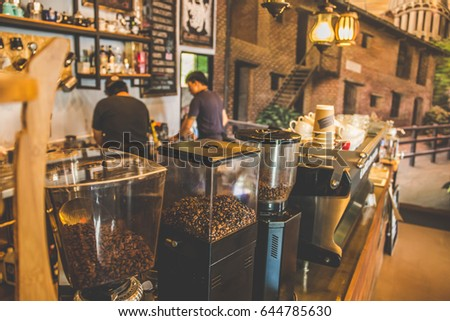 soft focus bar interior coffee maker in coffee shop and barista making coffee