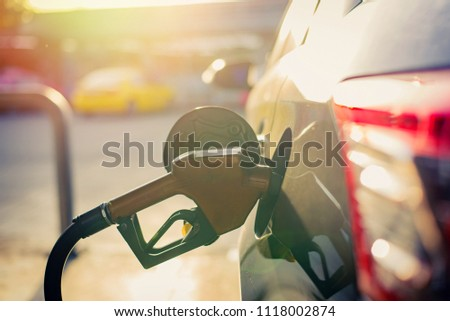 Soft focus,Fuel nozzle to refill fuel in car at gas station,copy space. #1118002874