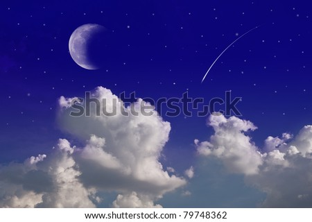 Soft focus moon with shooting star