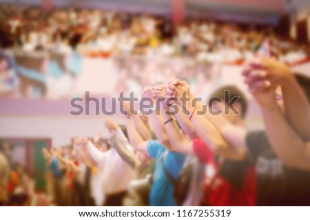 Soft focus of Christian worship with raised hand,music concert