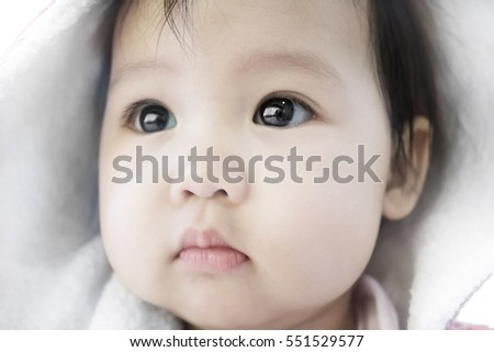 Stock Photo soft focus of cute asian baby with hood during winter