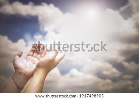 Soft focus of hands of human are pray and worship on blue sky background with sunlight, Soul of prayer man, Spirituality with believe and religion  Photo stock ©