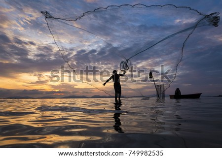 Soft focus of throwing fishing net during sunrise, Thailand #749982535
