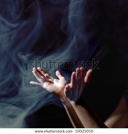 Soft focus photo based illustration of hands lifted up in a spiritual revelation to the light in an upward wave of incense smoke.