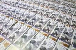 Soft focus photo. Money background. Dollar currency notes. Inflation rate. Economic crisis.