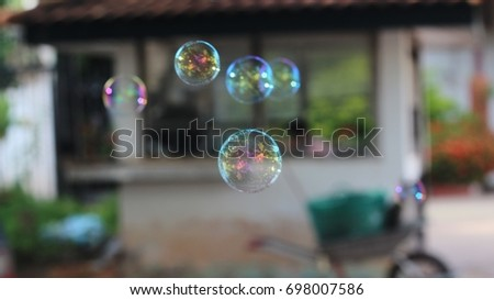 Soft focus Soap bubbles with bokeh background. Toy/decoration for Christmas, new year  background #698007586