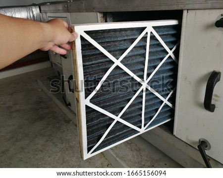 Soft Focus to Filter of Air handing Unit, Technician checking a Pre-filter of air handling unit for replacement a new filter - HVAC maintenance