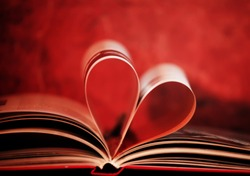 soft focused and colored book in shape of heart, book love concept