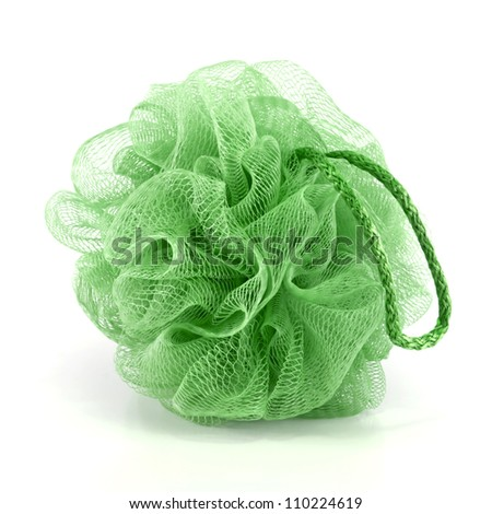 Soft green bath puff or sponge with rope handle isolated on white background.