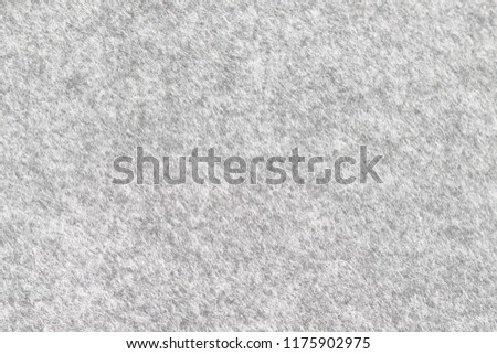 Soft grey felt material. Surface of felted fabric texture abstract background. High resolution photo.