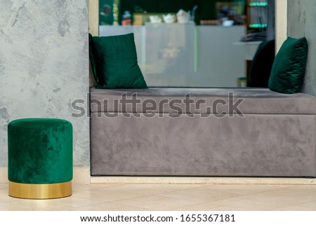 Soft grey sofa with two little pillows with one soft green round ottoman, mock up, interior.