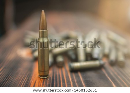 Soft Light and Smooth Focus,M16 ammunitions that have been used in the war have been prepared on wooden counters for ammunition drills to practice the accuracy of using firearms.