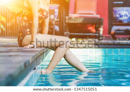 Soft Light & Smooth Focus, Asian women are relaxing by the pool to escape the hot summer of Thailand and are happy to relax during the holidays. Relaxation concept in summer #1347515051