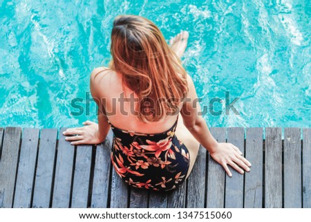 Soft Light & Smooth Focus, Asian women are relaxing by the pool to escape the hot summer of Thailand and are happy to relax during the holidays. Relaxation concept in summer #1347515060