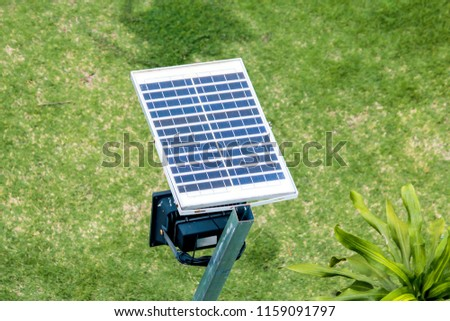 Soft light to solar cell panel street light above walk way side with blurred green grass background in countryside thailand.Green energy Concept.Selective focus. #1159091797