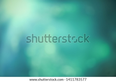 Soft lights abstract background. Blurred color texture with defocused lights.