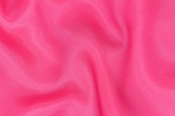 Soft, luxurious dark pink or satin fabric. It can be used as a glamorous wedding texture or background for a lovers ' holiday.