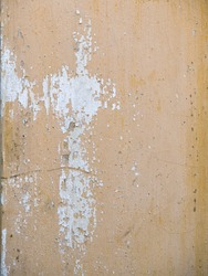 soft orange pastel vintage color congrete wall with cracks and faded peel off