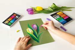 soft pastel drawing, painting of flowers. Pastel drawing tulips on paper, top view