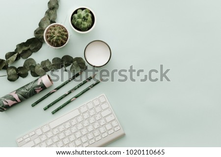 Soft Pastel Styled Desk Scenes With Keyboard ,green leaves and supplies. Flat lay
