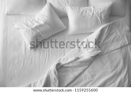 Soft pillows on comfortable bed, top view