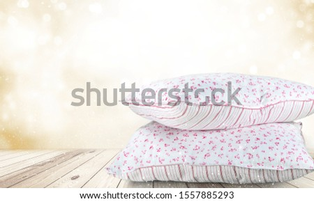 Soft Pillows Pile on grey background, three pillow, sleeping items.