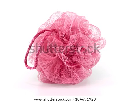 Soft pink bath puff or sponge isolated on white background with copy space.