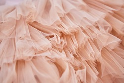 Soft pink fabric in pastel colors. Fabrics for luxury elegant dresses for children or adults.