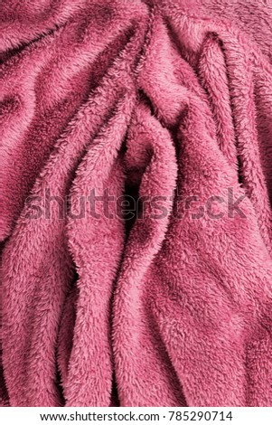 Soft pink fabric shaped as female genital organs, vagina