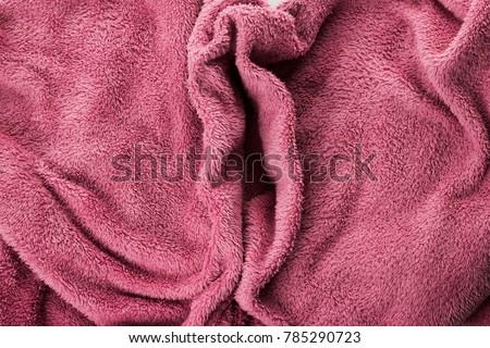 Soft pink fabric shaped as female genital organs, vaginoplasty, labiaplasty