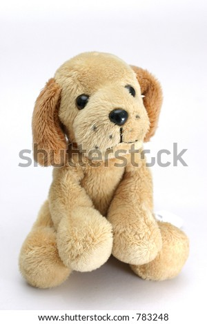 Soft plush toy dog looking cute straight into the camera