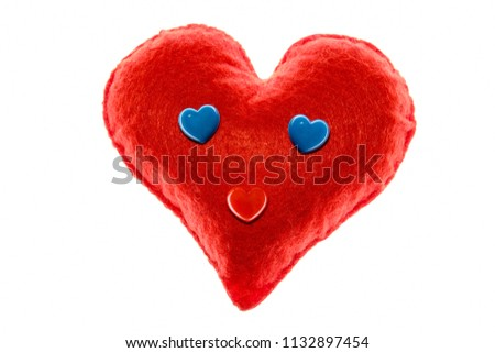 Soft red heart. Emotion with blue eyes. A symbol of love and happiness. Close-up. White background. #1132897454