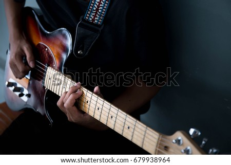 soft selective and blur focus.musician playing electric guitar.concept for live music background,Music festival.Instrument on stage,abstract musical background. #679938964