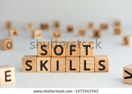 Soft skills - words from wooden blocks with letters, social  communication Soft skills concept, random letters around, white  background #1475961962
