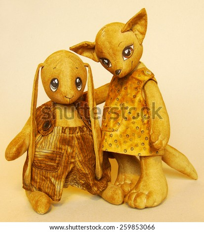 soft toy cat and rabbit sewn from fabric