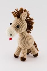 soft toy horse isolated on white background