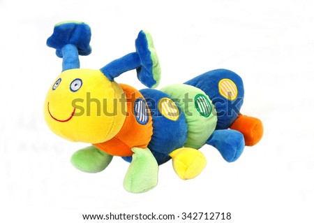 Stock Photo Soft toy of the caterpillar on isolated white background