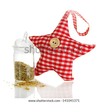 Soft toy shape of star with fragrant herbs isolated on white