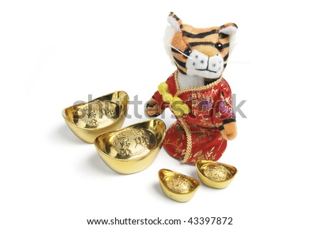 Soft Toy Tiger with Gold Ingots on White Background