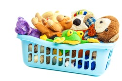 Soft toys in a plastic container isolated on white background.