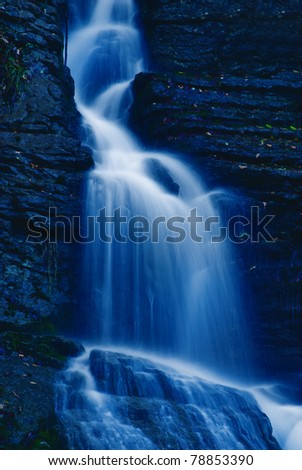 soft waterfall in the park in the night