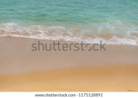 soft wave of an ocean on a sandy beach #1175128891
