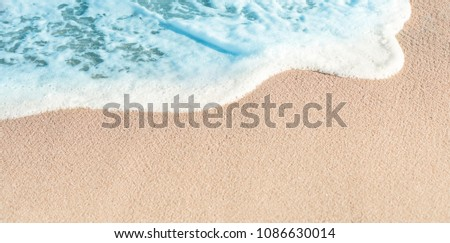 Soft Wave of Blue ocean in summer. Sandy Sea Beach  Background with copy space for text.