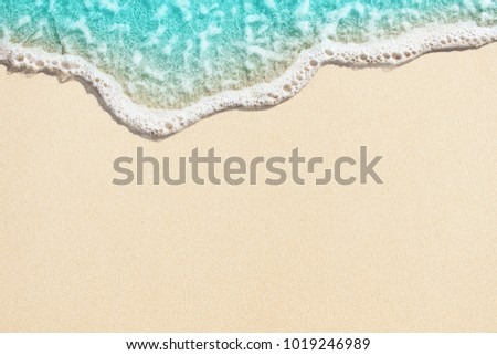 Soft wave of blue ocean on sandy beach. Background. #1019246989